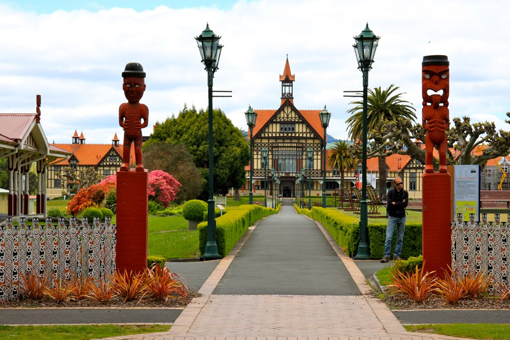A person standing in front of the Rotorua Museum in the Government Gardens Rotorua
